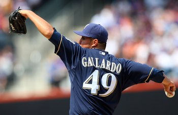 NEW YORK - APRIL 18:  Yovani Gallardo #49 of the Milwaukee Brewers deals a pitch against the New York Mets on April 18, 2009 at Citi Field in the Flushing neighborhood of the Queens borough of New York City.  (Photo by Jim McIsaac/Getty Images)
