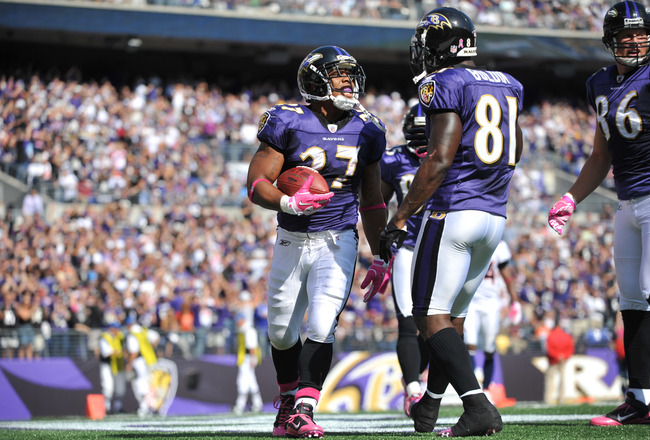 BALTIMORE, MD - OCTOBER 10: Ray Rice #27 of the Baltimore Ravens celebrates a touchdown against the Denver Broncos at M&T Bank Stadium on October 10, 2010 in Baltimore, Maryland. Players wore pink in recognition of Breast Cancer Awareness Month. The Raven