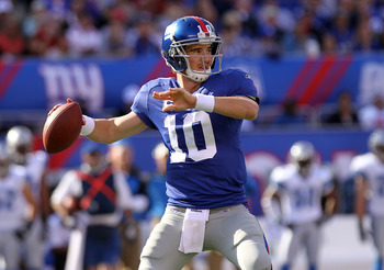EAST RUTHERFORD, NJ - OCTOBER 17:  Eli Manning #10 of the New York Giants passes against the Detroit Lions at New Meadowlands Stadium on October 17, 2010 in East Rutherford, New Jersey.  (Photo by Nick Laham/Getty Images)