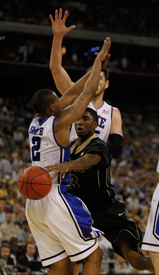 HOUSTON - MARCH 26: E'Twaun Moore #33 of the Purdue Boilermakers passes around Nolan Smith #2 of the Duke Blue Devils during the south regional semifinal of the 2010 NCAA men's basketball tournament at Reliant Stadium on March 26, 2010 in Houston, Texas.