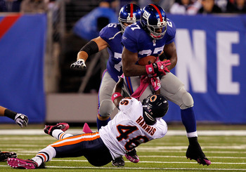 EAST RUTHERFORD, NJ - OCTOBER 03:  Chris Harris #46 of the Chicago Bears tries to tackle Brandon Jacobs #27 of the New York Giants at New Meadowlands Stadium on October 3, 2010 in East Rutherford, New Jersey.  (Photo by Michael Heiman/Getty Images)