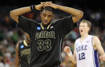 HOUSTON - MARCH 26: E'Twaun Moore #33 of the Purdue Boilermakers reacts in a 70-57 loss against the Duke Blue Devils during the south regional semifinal of the 2010 NCAA men's basketball tournament at Reliant Stadium on March 26, 2010 in Houston, Texas. (