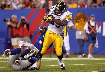 EAST RUTHERFORD, NJ - AUGUST 21: Isaac Redman #33 of the Pittsburgh Steelers rushes in for a touchdown against the New York Giants during their preseason game at New Meadowlands Stadium on August 21, 2010 in East Rutherford, New Jersey.  (Photo by Nick La