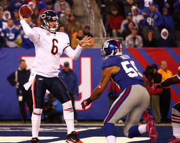 EAST RUTHERFORD, NJ - OCTOBER 03:  Jay Cutler #6 of the Chicago Bears drops back to pass against Michael Boley #59 of the New York Giants at New Meadowlands Stadium on October 3, 2010 in East Rutherford, New Jersey.  (Photo by Andrew Burton/Getty Images)