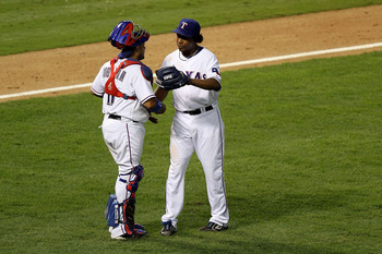 ARLINGTON, TX - OCTOBER 16: (L-R) Bengie Molina #11 and Neftali Feliz #30 of the Texas Rangers celebrate after they won 7-2 against the New York Yankees in Game Two of the ALCS during the 2010 MLB Playoffs at Rangers Ballpark in Arlington on October 16, 2