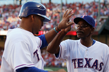 ARLINGTON, TX - OCTOBER 16:  Manager Ron Washington of the Texas Rangers congratulates Nelson Cruz #17 after Cruz scored in the bottom of the fifth inning against the New York Yankees in Game Two of the ALCS during the 2010 MLB Playoffs at Rangers Ballpar