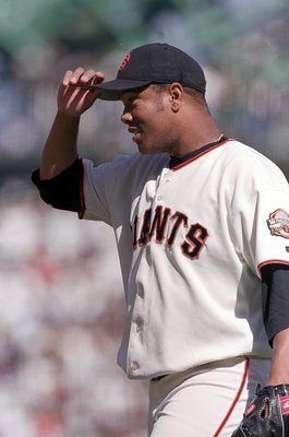 4 Oct 2000:  Livan Hernandez #61 of the San Francisco Giants walks to the mound during the NLDS Game against the New York Mets at Pac Bell Park in San Francisco, California. The Giants defeated the Mets 5-1.Mandatory Credit: Tom Hauck  /Allsport