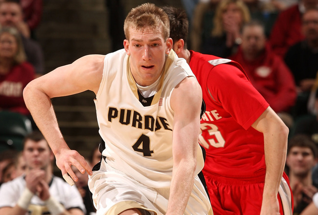INDIANAPOLIS - MARCH 15:  Robbie Hummel #4 of the Purdue Boilermakers brings the ball up court against the Ohio State Buckeyes during the final of the Big Ten Men's Basketball Tournament at Conseco Fieldhouse on March 15, 2009 in Indianapolis, Indiana.  (