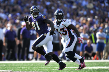 BALTIMORE, MD - OCTOBER 10: Anquan Boldin #81 of the Baltimore Ravens goes out for a pass against the Denver Broncos at M&T Bank Stadium on October 10, 2010 in Baltimore, Maryland. Players wore pink in recognition of Breast Cancer Awareness Month. The Rav