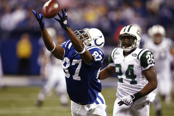 INDIANAPOLIS, IN - DECEMBER 27: Reggie Wayne #87 of the Indianapolis Colts tries to make a reception behind Darrelle Revis #24 of the New York Jets at Lucas Oil Stadium on December 27, 2009 in Indianapolis, Indiana. The Jets handed the Colts their first l