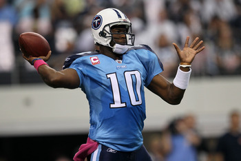 ARLINGTON, TX - OCTOBER 10:  Quarteback Vince Young #10 of the Tennessee Titans throws a pass against the Dallas Cowboys at Cowboys Stadium on October 10, 2010 in Arlington, Texas.  (Photo by Stephen Dunn/Getty Images)