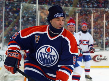 EDMONTON, CANADA - NOVEMBER 22:  Glenn Anderson #9 of the Edmonton Oilers skates after the play during the Molson Canadien Heritage Classic against the Montreal Canadiens on November 22, 2003 at Commonwealth Stadium in Edmonton, Canada. The Oilers defeate