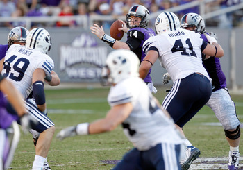 FORT WORTH, TX - OCTOBER 16:  Quarterback Andy Dalton #14 of the TCU Horned Frogs throws a pass against the BYU Cougars at Amon G. Carter Stadium on October 16, 2010 in Fort Worth, Texas. TCU beat BYU 31-3. (Photo by Tom Pennington/Getty Images)