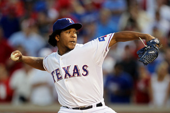 ARLINGTON, TX - OCTOBER 16:  Neftali Feliz #30 of the Texas Rangers pitches against the New York Yankees in Game Two of the ALCS during the 2010 MLB Playoffs at Rangers Ballpark in Arlington on October 16, 2010 in Arlington, Texas.  (Photo by Stephen Dunn