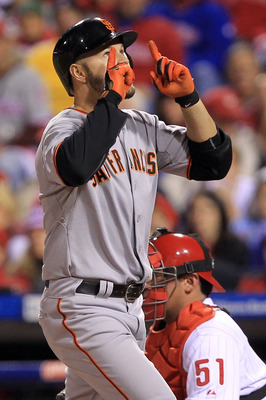 PHILADELPHIA - OCTOBER 16:  Cody Ross #13 of the San Francisco Giants reacts after a fifth inning home run against the Philadelphia Phillies in Game One of the NLCS during the 2010 MLB Playoffs at Citizens Bank Park on October 16, 2010 in Philadelphia, Pe