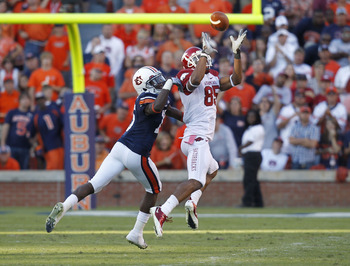 AUBURN - OCTOBER 16:  Wide receiver Greg Childs #85 of the Arkansas Razorbacks catches a pass behind defensive back Neiko Thorpe #15 of the Auburn Tigers during the game at Jordan-Hare Stadium on October 16, 2010 in Auburn, Alabama.  The Tigers beat the R