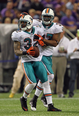 MINNEAPOLIS - SEPTEMBER 19:  Jason Allen #32 of the Miami Dolphins is congratulated by Yeremiah Bell #37 after an interception during the game on September 19, 2010 at Hubert H. Humphrey Metrodome in Minneapolis, Minnesota.  (Photo by Jamie Squire/Getty I