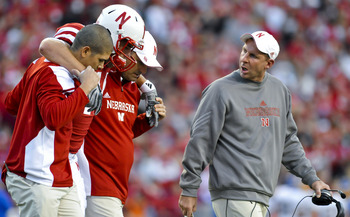 LINCOLN, NEBRASKA - SEPTEMBER 25: Nebraksa Cornhusker head coach Bo Pelini (R) checks on injured Nebraska Cornhuskers tight end Mike McNeill #44 their game against the South Dakota State Jackrabbits at Memorial Stadium on September 25, 2010 in Lincoln, Ne