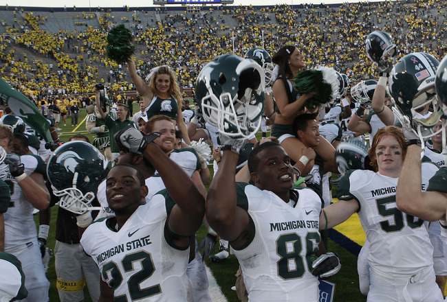 ANN ARBOR, MI - OCTOBER 09: Josh Bodell #22 and Fred Smith #86 of the Michigan State Spartans celebrate their win over the Michigan Wolverines 34-17 on October 9, 2010 at Michigan Stadium in Ann Arbor, Michigan. (Photo by Leon Halip/Getty Images)