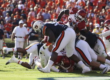 AUBURN - OCTOBER 16:  Running back Broderick Green #29 of the Arkansas Razorbacks (top right) scores a touchdown over the top during the game against the Auburn Tigers at Jordan-Hare Stadium on October 16, 2010 in Auburn, Alabama.  (Photo by Mike Zarrilli