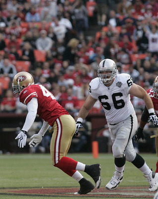 SAN FRANCISCO - AUGUST 22:  Oakland Raiders quarterback Jeff Garcia #7 gets rid of the ball as he is pressured by San Francisco 49ers linebacker Diyral Briggs #47 as Oakland Raiders guard Cooper Carlisle #66 looks on during the 2nd quarter as the San Fran