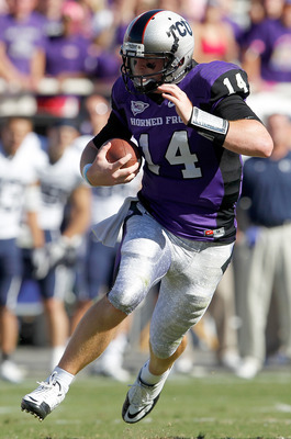 FORT WORTH, TX - OCTOBER 16:  Quarterback Andy Dalton #14 of the TCU Horned Frogs scrambles with the ball against the BYU Cougars at Amon G. Carter Stadium on October 16, 2010 in Fort Worth, Texas.  TCU beat BYU 31-3. (Photo by Tom Pennington/Getty Images