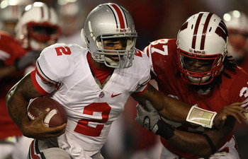 MADISON, WI - OCTOBER 16: Terrelle Pryor #2 of the Ohio State Buckeyes rushes against Kevin Claxton #37 of the Wisconsin Badgers at Camp Randall Stadium on October 16, 2010 in Madison, Wisconsin. Wisconsin defeated Ohio State 31-18. (Photo by Jonathan Dan
