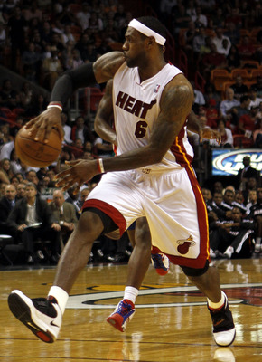 MIAMI - OCTOBER 05:  Forward LeBron James #6 plays against the Detroit Pistons on October 5, 2010 in Miami, Florida.  NOTE TO USER: User expressly acknowledges and agrees that, by downloading and or using this photograph, User is consenting to the terms a