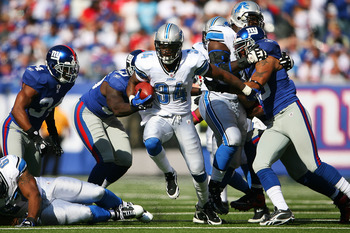EAST RUTHERFORD, NJ - OCTOBER 17: Kevin Smith #34 of the Detroit Lions runs the ball against the New York Giants at New Meadowlands Stadium on October 17, 2010 in East Rutherford, New Jersey. The Giants defeated the Lions 28 - 20. (Photo by Andrew Burton/
