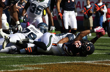 CHICAGO - OCTOBER 17: Matt Forte #22 of the Chicago Bears scores a touchdown as he is tackled by Earl Thomas #29 of the Seattle Seahawks at Soldier Field on October 17, 2010 in Chicago, Illinois. The Seahawks defeated the Bears 23-20. (Photo by Jonathan D