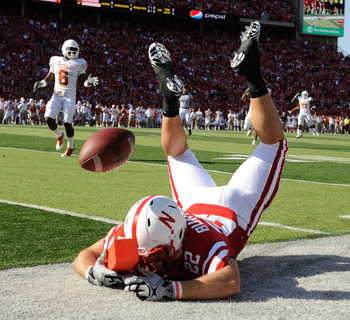 LINCOLN, NE - OCTOBER 16: Running back Rex Burkhead #22 of the Nebraska Cornhuskers just misses a reception during first half action of their game at Memorial Stadium on October 16, 2010 in Lincoln, Nebraska. Texas Defeated Nebraska 20-13. (Photo by Eric