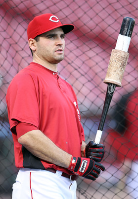 CINCINNATI - OCTOBER 10: Joey Votto #19 of the Cincinnati Reds participates in batting practice before the start of  Game 3 of the NLDS against the Philadelphia Phillies  at Great American Ball Park on October 10, 2010 in Cincinnati, Ohio.  (Photo by Andy