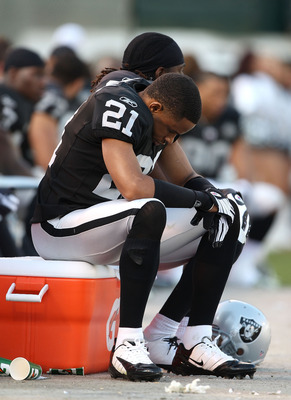 OAKLAND, CA - JANUARY 3:  Nnamdi Asomugha #21 of the Oakland Raiders sits on the bench against the Baltimore Ravens during an NFL game at Oakland-Alameda County Coliseum on January 3, 2010 in Oakland, California. (Photo by Jed Jacobsohn/Getty Images)