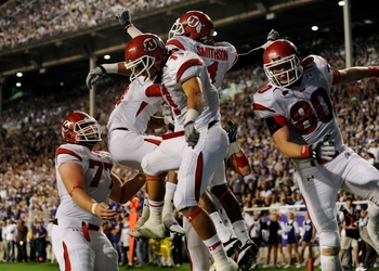 FORT WORTH, TX - NOVEMBER 14:  Shaky Smithson #1 of the Utah Utes celebrates with teammates after scoring a touchdown in the first quarter of the game against the TCU Horned Frogs at Amon G. Carter Stadium on November 14, 2009 in Fort Worth, Texas.  (Phot