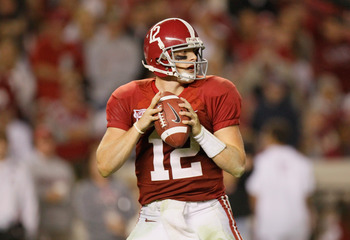 TUSCALOOSA, AL - OCTOBER 16:  Quarterback Greg McElroy #12 of the Alabama Crimson Tide looks to pass against the Ole Miss Rebels at Bryant-Denny Stadium on October 16, 2010 in Tuscaloosa, Alabama.  (Photo by Kevin C. Cox/Getty Images)