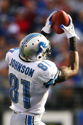 EAST RUTHERFORD, NJ - OCTOBER 17: Calvin Johnson #81 of the Detroit Lions catches the ball on an 87-yard touchdown run in the third quarter against the New York Giants at New Meadowlands Stadium on October 17, 2010 in East Rutherford, New Jersey. The Gian
