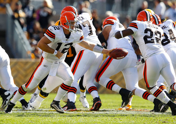 PITTSBURGH - OCTOBER 17: Colt McCoy #12 of the Cleveland Browns hands the ball off to teammate Mike Bell #22 during the game against the Pittsburgh Steelers on October 17, 2010 at Heinz Field in Pittsburgh, Pennsylvania.  (Photo by Jared Wickerham/Getty I