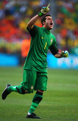 PORT ELIZABETH, SOUTH AFRICA - JULY 02:  Julio Cesar of Brazil celebrates Robinho's opening goal during the 2010 FIFA World Cup South Africa Quarter Final match between Netherlands and Brazil at Nelson Mandela Bay Stadium on July 2, 2010 in Nelson Mandela