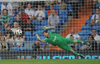 MADRID, SPAIN - SEPTEMBER 21:  Real Madrid goalkeeper Iker Casillas makes a save during the La Liga match between Real Madrid and Espanyol at Estadio Santiago Bernabeu on September 21, 2010 in Madrid, Spain.  (Photo by Denis Doyle/Getty Images)