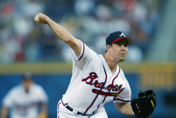 ATLANTA - APRIL 18:  Starting pitcher Greg Maddux #31 of the Atlanta Braves in action during the first inning of the game against the Philadelphia Phillies at Turner Fieldon April 18, 2002 in Atlanta, Georgia.  The Braves defeated the Phillies 5-4.  (Phot