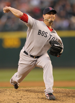 SEATTLE - JULY 23: Starting pitcher Josh Beckett #19 of the Boston Red Sox pitches against the Seattle Mariners at Safeco Field on July 23, 2010 in Seattle, Washington. (Photo by Otto Greule Jr/Getty Images)