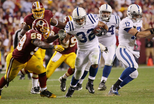 LANDOVER, MD - OCTOBER 17:  Running back Mike Hart #32 of the Indianapolis Colts is tackled by London Fletcher #59 of the Washington Redskins at FedEx Field on October 17, 2010 in Landover, Maryland. The Colts won the game 27-24.  (Photo by Win McNamee/Ge
