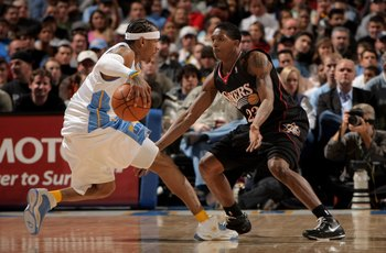 DENVER - JANUARY 06:  Allen Iverson #3 of the Denver Nuggets controls the ball as Louis Williams #23 of the Philadelphia 76ers defends at the Pepsi Center on January 6, 2008 in Denver, Colorado. The Nuggets defeated the Sixers 109-96. NOTE TO USER: User e