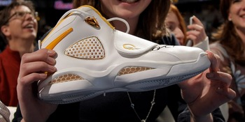 DENVER - MARCH 16:  Bridgette Anthony, 13, of Louisville, Colorado shows off the signed sneaker given to her by Allen Iverson #3 of the Denver Nuggets after leaving the game in the third quarter against the Seattle SuperSonics at the Pepsi Center March 16
