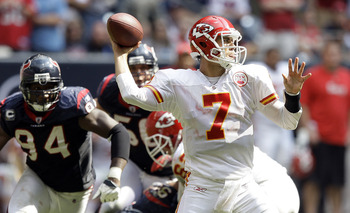 HOUSTON - OCTOBER 17:  Quarterback Matt Cassel #7 of the Kansas City Chiefs throws down field as Antonio Smith #94 of the Houston Texans looks to apply pressure> at Reliant Stadium on October 17, 2010 in Houston, Texas.  (Photo by Bob Levey/Getty Images)