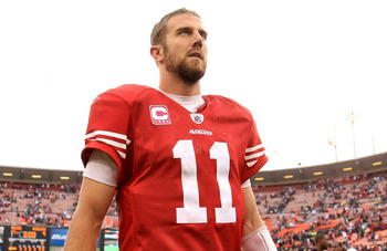 SAN FRANCISCO - OCTOBER 17: Alex Smith #11 of the San Francisco 49ers walks off the field after they beat the Oakland Raiders at Candlestick Park on October 17, 2010 in San Francisco, California.  (Photo by Ezra Shaw/Getty Images)