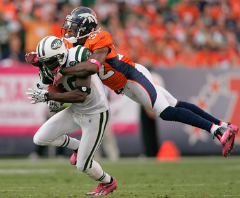 DENVER - OCTOBER 17:  Wide receiver Santonio Holmes #10 the New York Jets is tackled by cornerback Perrish Cox #32 of the Denver Broncos at INVESCO Field at Mile High on October 17, 2010 in Denver, Colorado.  (Photo by Justin Edmonds/Getty Images)