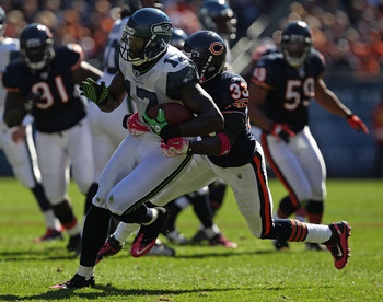 CHICAGO - OCTOBER 17: Mike Williams #17 of the Seattle Seahawks runs for a first down while being grabbed by Charles Tillman #33 of the Chicago Bears at Soldier Field on October 17, 2010 in Chicago, Illinois. (Photo by Jonathan Daniel/Getty Images)