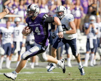 FORT WORTH, TX - OCTOBER 16:  Quarterback Andy Dalton #14 of the Texas Christian University Horned Frogs scrambles with the ball against the Brigham Young University Cougars at Amon G. Carter Stadium on October 16, 2010 in Fort Worth, Texas.  (Photo by To
