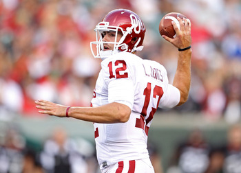 CINCINNATI - SEPTEMBER 25:  Landry Jones #12 of the Oklahoma Sooners throws a pass during the game against the Cincinnati Bearcats at Paul Brown Stadium on September 25, 2010 in Cincinnati, Ohio.  (Photo by Andy Lyons/Getty Images)